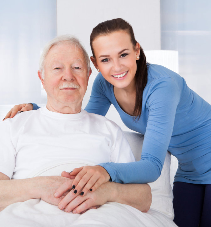 Caregiver and her patient smiling at camera