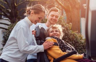 caregivers assist senior